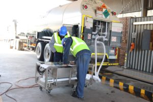 Verification Officers recording results and verifying the flow meter